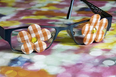 Closeup of girl child glasses with funky flowers on the eye lens stock photo