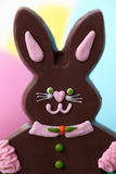 Girl chocolate Easter bunny Stock Photo
