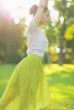 Closeup on girl dancing on meadow Stock Photography