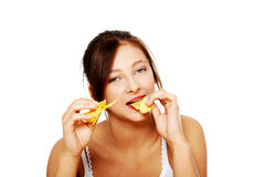 Closeup on girl eating chips. Stock Image