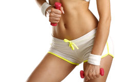 Closeup of a girl exercising with dumbbells Stock Photo