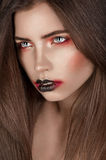 Closeup girl with expresive black and red makeup Royalty Free Stock Photos