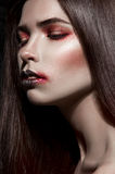 Closeup girl with expresive black and red makeup Royalty Free Stock Image