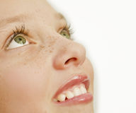Closeup of girl with freckles on her face Stock Photos