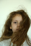 Closeup of girl with hair blowing Stock Photography