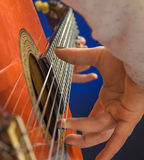 Closeup of a Girl hand playing classical gutar Royalty Free Stock Photos