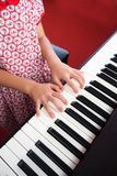 Closeup girl hand playing piano. Favorite music for learning to basic of music and rhythm skill.