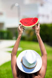 Closeup girl in hat and sunglasses with watermelon Stock Photo