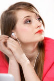 Closeup girl with headphones listen music Royalty Free Stock Images