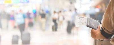 Closeup of girl holding passports and boarding pass at airport , Royalty Free Stock Photo