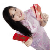 Closeup girl holds chinese envelope Stock Photography