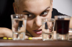 Closeup of a girl lusting for alcohol Stock Photography