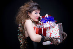 Closeup girl with red lips, tinsel and present Stock Photos