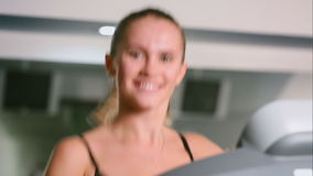 A closeup of the girl running in the gym stock video footage