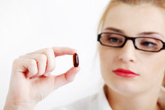 Closeup on girl`s hand with the pill. Royalty Free Stock Photography