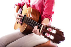 Closeup of girl´s hands playing acoustic quitar Stock Image