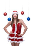Closeup of girl in santa dress and christmas balls Stock Photo