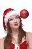 Closeup of girl in santa dress and christmas balls Stock Photos