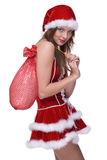 Closeup of girl in santa dress and gifts bag Royalty Free Stock Image