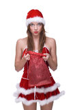 Closeup of girl in santa dress and gifts bag Stock Photos