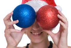 Closeup girl in santa hat and decoration balls Stock Photos