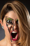 Closeup of Girl Screaming with Lightning Makeup Royalty Free Stock Photos