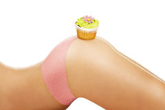 Closeup on a girl showing a cupcake on her body Royalty Free Stock Photos