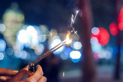 Closeup of Girl with Sparkle. Close up of woman holding sparkler Royalty Free Stock Image