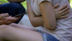 Closeup of girl suffering abdominal pain, worried man calling ambulance, help royalty free stock photo