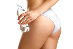 Closeup of a girl in underwear holding a little bottle of water Stock Photos