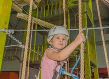 Closeup of a girl in a white helmet in the adventure Park. In the adventure Park the kid in the white helmet, close-up Stock Photo