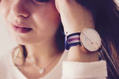 Closeup of girl with wrist watch