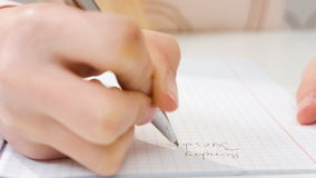 Closeup girl writing in exercise book stock video