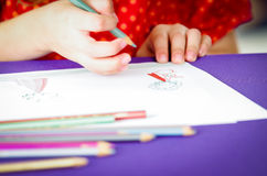 Closeup of girls' hands drawing Royalty Free Stock Photos