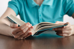 Closeup of girls handswhile reading book Royalty Free Stock Photography
