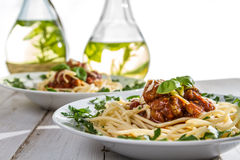 Closeup of a given spaghetti on a plate Royalty Free Stock Image
