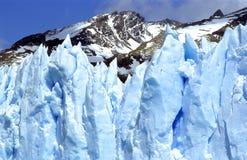 A closeup of Glacier Perito Moreno, Part II. Part of Perito Moreno Glacier with a mountain in the back Stock Photography