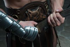 Closeup of gladiator holding sword Stock Images