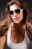 Closeup of Glamour woman. With sunglasses on black background stock photo
