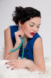 Closeup glamour woman on white fur. Beads Stock Photography