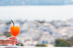 Closeup glass with alcohol drink background in beautiful old Mykonos in Greece Stock Images