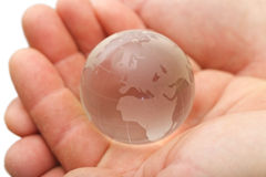 Glass globe in hands Stock Photography