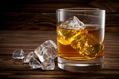 Closeup of glass with ice and whiskey Royalty Free Stock Images
