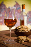 Closeup of a glass of Italian vin santo wine and cantucci biscui Royalty Free Stock Photo
