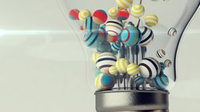 Closeup of Glass Light Bulb with Balls. An exciting 3d rendering of a transparent glass ligh bulb with a metallic wire and small striped and multicolored balls Royalty Free Stock Image