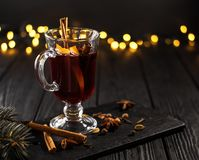 Closeup glass of mulled wine with orange and cinnamon stock photo