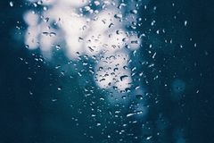 Closeup of a glass with water drips on it after a rain - beautiful background royalty free stock image