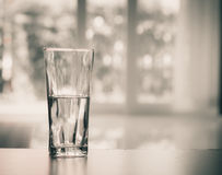 Closeup Glass of water on table in the living room , vintage and retro style Stock Photography