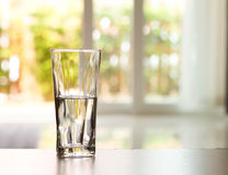 Closeup Glass of water on table in the living room , vintage and retro style Royalty Free Stock Photography