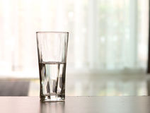 Closeup Glass of water on table in the living room , vintage and retro style Stock Photos